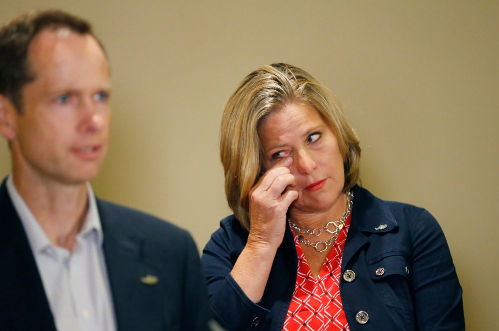 Jill McCluskey wipes her eye as her husband Matthew speaks during a news conference, Thursday, June 27, 2019, in Salt Lake City. The family of Lauren McCluskey, a University of Utah student shot on campus, sued the institution on Thursday June 27, 2019, saying officials have refused to take responsibility for missing chances to prevent her death despite multiple reports to police. Lauren McCluskey's parents said they hope the suit can help protect other women at risk of dating violence on college campuses.(AP Photo/Rick Bowmer)