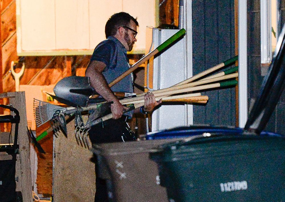 Police investigators carry in multiple rakes and shovels into the backyard of a home at 547 N. 1000 West in Salt Lake City as part of the disappearance of University of Utah student MacKenzie Lueck on Wednesday, June 26, 2019. Police said Thursday that the owner of a home they searched in connection with the disappearance is a