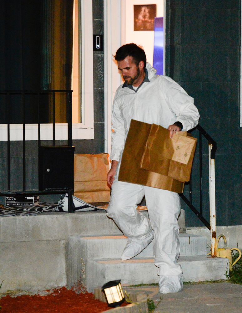 Police investigators remove multiple bags of evidence during their search of a home in Salt Lake City as part of the disappearance of University of Utah student MacKenzie Lueck that carried on into the early morning hours of Thursday, June 27, 2019.  (Francisco Kjolseth/The Salt Lake Tribune via AP)