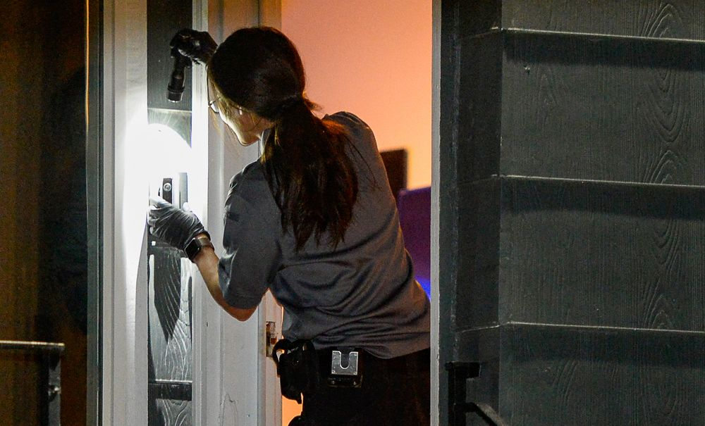 Police investigators search oa home in Salt Lake City as part of the disappearance of University of Utah student MacKenzie Lueck that carried on into the early morning hours of Thursday, June 27, 2019.  (Francisco Kjolseth/The Salt Lake Tribune via AP)