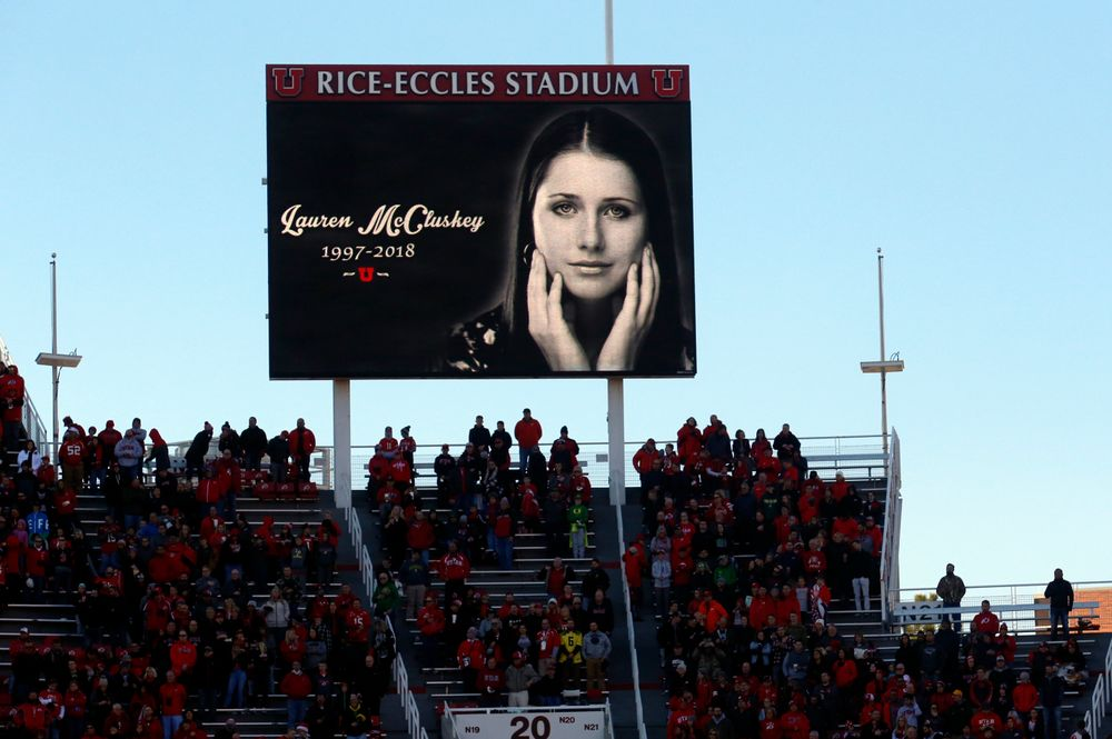 FILE - In this Nov. 10, 2018, file photo, a photograph of University of Utah student and track athlete Lauren McCluskey, who was fatally shot on campus, is projected on the video board before the start of an NCAA college football game between Oregon and Utah in Salt Lake City. The family of a University of Lauren McCluskey sued the institution on Thursday, June 27, 2019, saying officials have refused to take responsibility for missing chances to prevent her death despite multiple reports to police. (AP Photo/Rick Bowmer, File)
