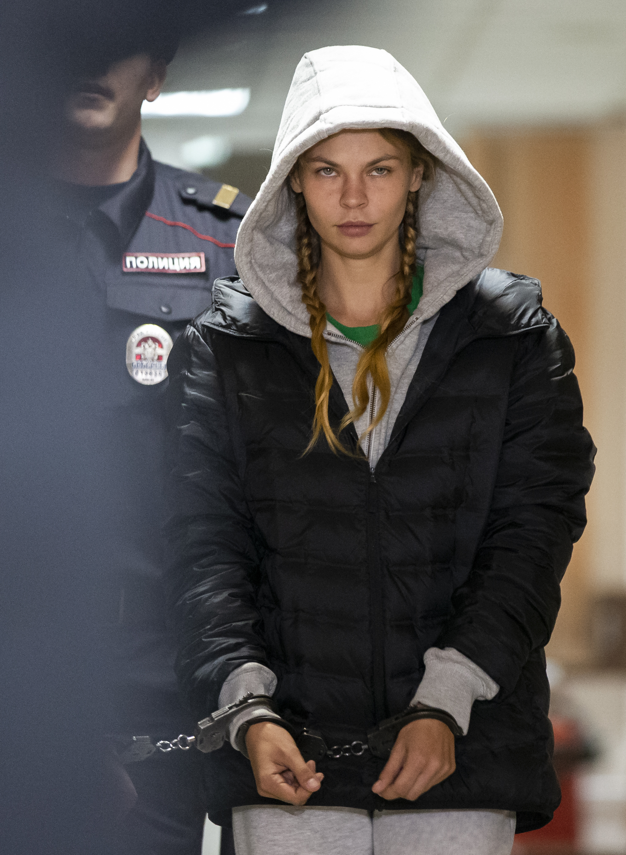 Anastasia Vashukevich, also known on social media as Nastya Rybka is escorted in the court room in Moscow, Russia, Saturday, Jan. 19, 2019. A Belarusian model who claimed last year that she had evidence of Russian interference in the election of Donald Trump as U.S. president was arrested immediately upon her arrival in Moscow on Thursday following deportation from Thailand. (AP Photo/Alexander Zemlianichenko)
