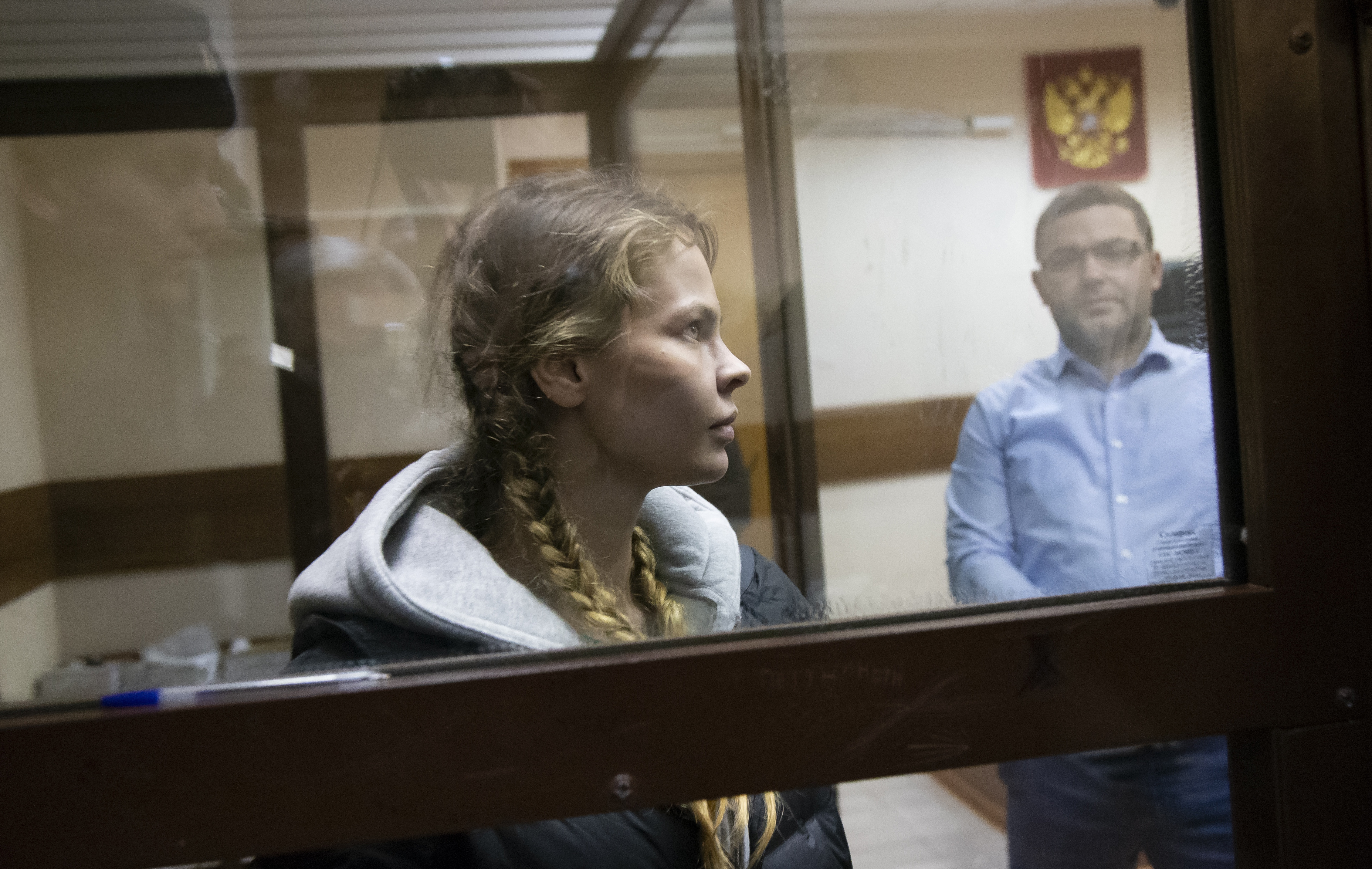 Anastasia Vashukevich, also known on social media as Nastya Rybka, waits for a court session in the court room in Moscow, Russia, Saturday, Jan.19, 2019. A Belarusian model who claimed last year that she had evidence of Russian interference in the election of Donald Trump as U.S. president was arrested immediately upon her arrival in Moscow on Thursday following deportation from Thailand. (AP Photo/Alexander Zemlianichenko)