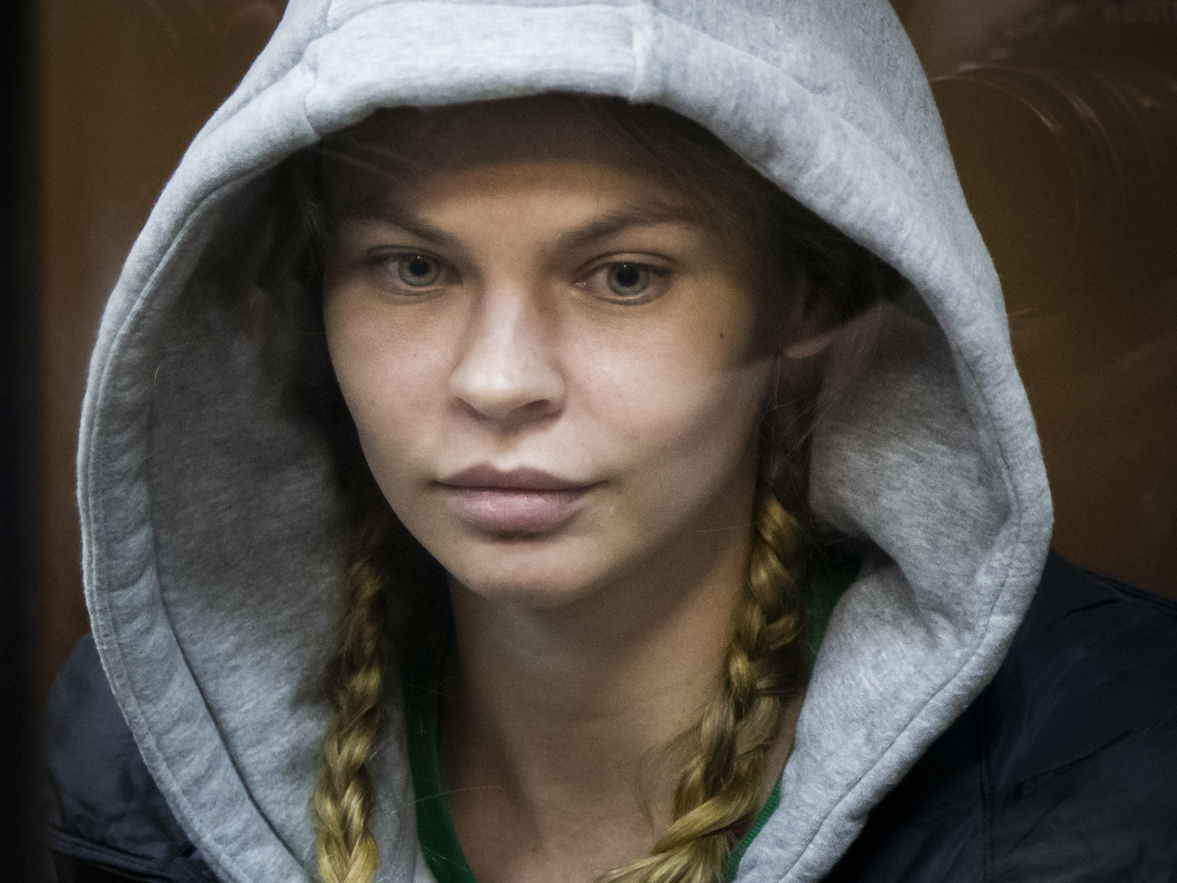 Anastasia Vashukevich, also known on social media as Nastya Rybka, sits in a cage in the court room in Moscow, Russia, Saturday, Jan. 19, 2019. A Belarusian model who claimed last year that she had evidence of Russian interference in the election of Donald Trump as U.S. president was arrested immediately upon her arrival in Moscow on Thursday following deportation from Thailand. (AP Photo/Alexander Zemlianichenko)