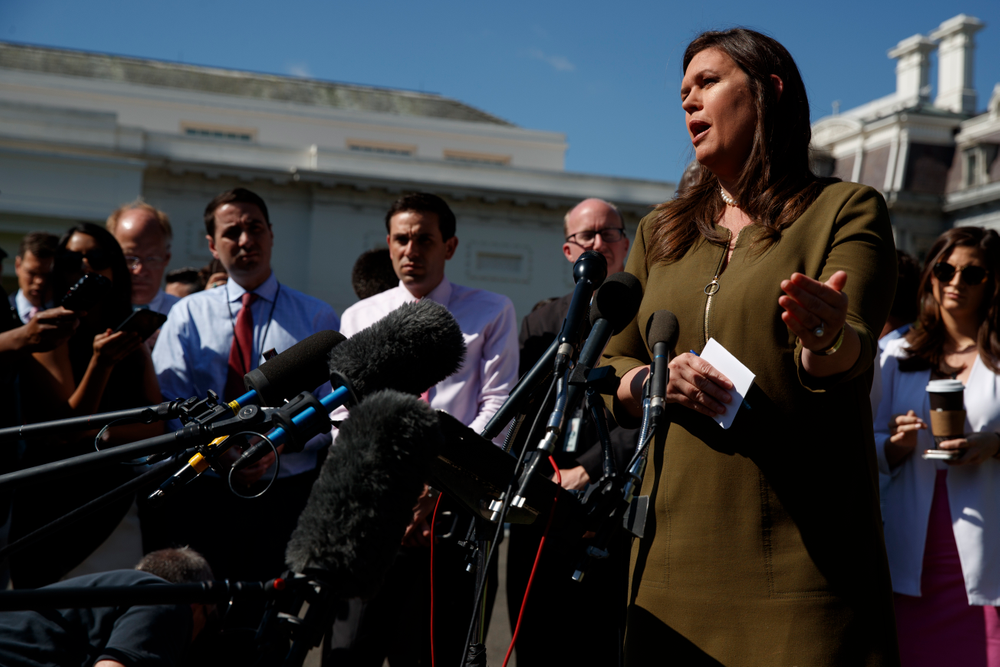 White House press secretary Sarah Sanders talks to reporters outside the White House, Friday, May 31, 2019, in Washington. (AP Photo/Evan Vucci)