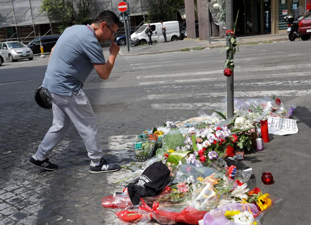 A man wipes his eyes after leaving flowers on the spot where Mario Cerciello Rega was stabbed to death, in Rome, Saturday, July 27, 2019. In a statement Saturday, Carabinieri officers investigating the death Friday of officer Cerciello Rega, 35, said two American turists, both 19, have been detained for alleged murder and attempted extortion. (AP Photo/Andrew Medichini)