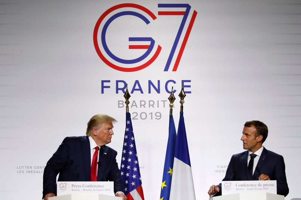 French President Emmanuel Macron and U.S President Donald Trump attend the final press conference during the G7 summit Monday, Aug. 26, 2019 in Biarritz, southwestern France. French president says he hopes for meeting between US President Trump and Iranian President Rouhani in coming weeks. (AP Photo/Francois Mori)