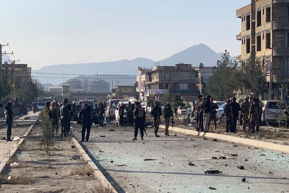 Afghan security personnel gather at the site of an explosion in Kabul, Afghanistan, Wednesday, Nov. 13, 2019. An explosion has rocked the Afghan capital of Kabul as early morning commuters were on the street heading to work. (AP Photo/Rahmat Gul)