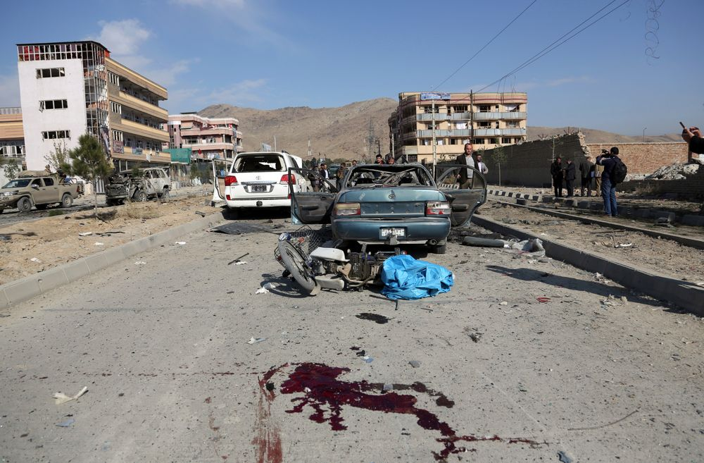 Blood stains the ground after a car bomb attack in Kabul, Afghanistan, Wednesday, Nov. 13, 2019. A car bomb detonated in the Afghan capital during Wednesday's morning commute, killing seven people and wounding at least seven, officials said. (AP Photo/Rahmat Gul)