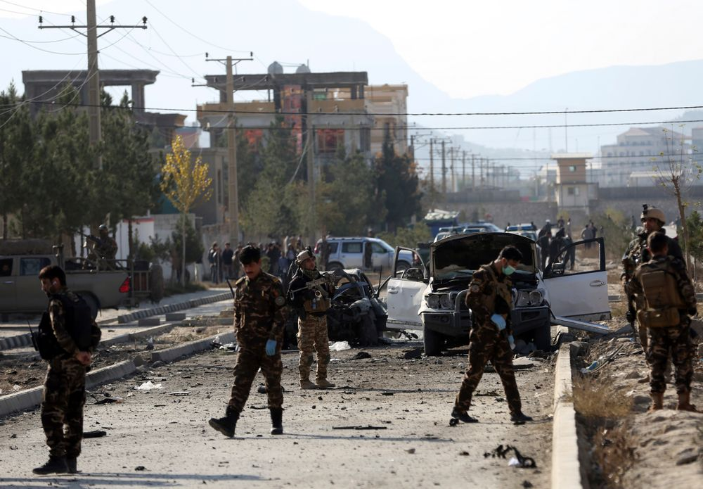 Afghan security personnel gather at the site of car bomb attack in Kabul, Afghanistan, Wednesday, Nov. 13, 2019. A car bomb detonated in the Afghan capital of Kabul during Wednesday's morning commute, killing several people, officials said. (AP Photo/Rahmat Gul)