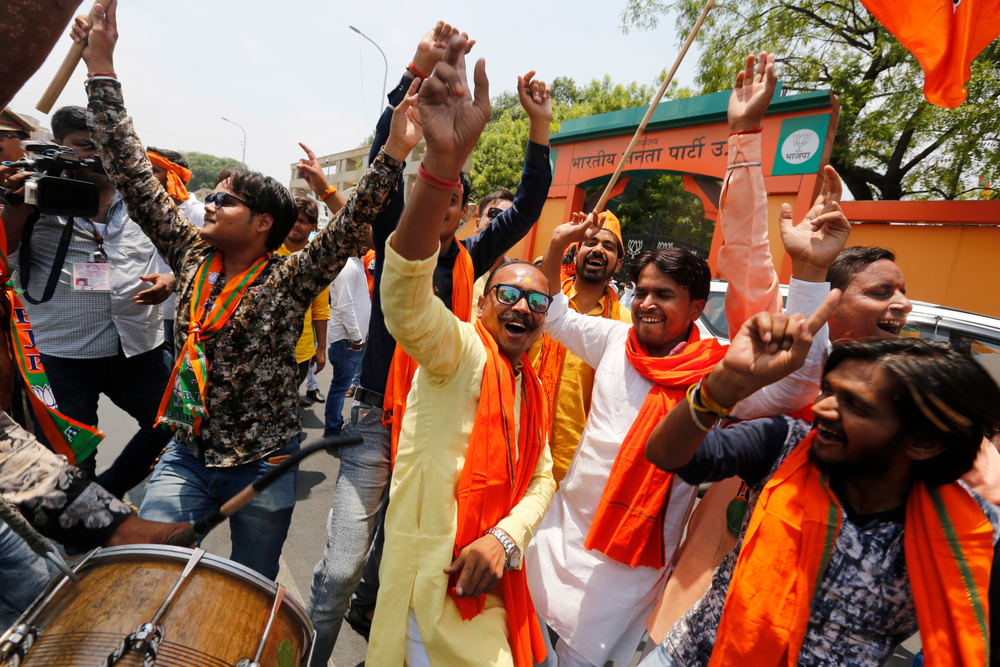 Bharatiya Janata Party (BJP) workers celebrate at BJP headquarters in, Lucknow, India, Thursday, May 23, 2019.  Indian Prime Minister Narendra Modi and his party were off to an early lead as vote counting began Thursday following the conclusion of the country's 6-week-long general election, sending the stock market soaring in anticipation of another five-year term for the Hindu nationalist leader.(AP Photo/Rajesh Kumar Singh)