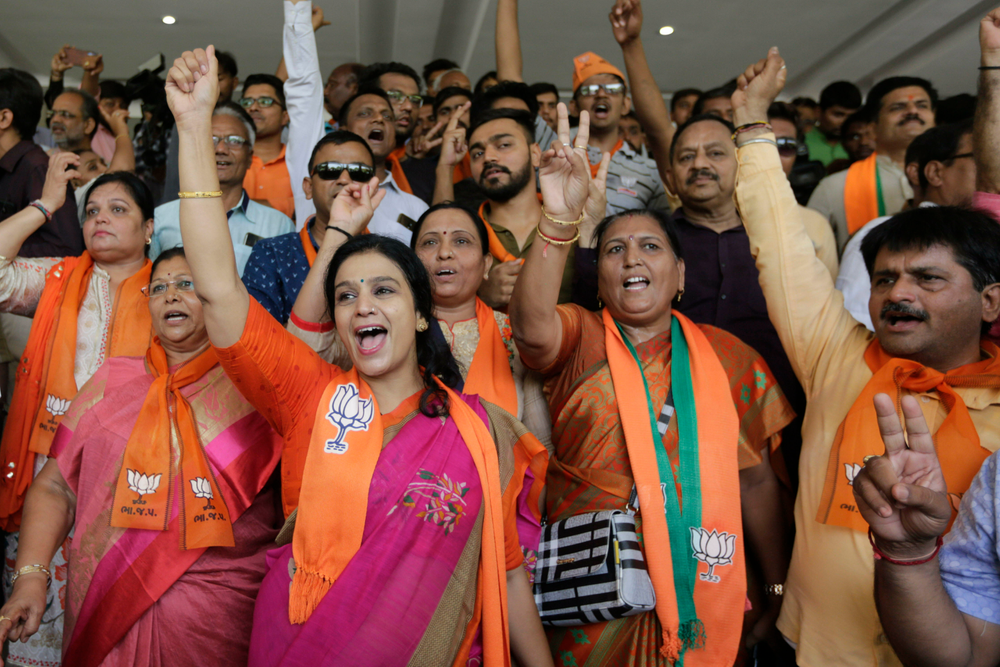 Supporters of India's ruling Bharatiya Janata Party celebrates early trends of party's victory in general elections at party's state head quarter in Gandhinagar, India, Thursday, May 23, 2019. (AP Photo/Ajit Solanki)
