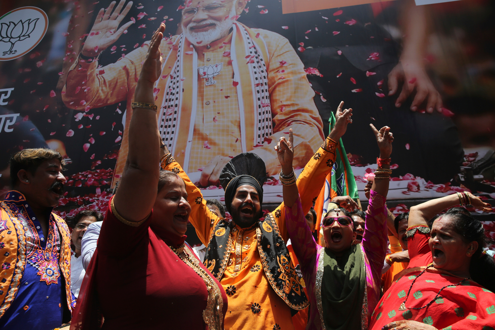 Bharatiya Janata Party (BJP) workers celebrate outside BJP headquarters in Mumbai, India, Thursday, May 23, 2019. Indian Prime Minister Narendra Modi and his party were off to an early lead as vote counting began Thursday following the conclusion of the country's 6-week-long general election, sending the stock market soaring in anticipation of another five-year term for the Hindu nationalist leader. (AP Photo/Rafiq Maqbool)