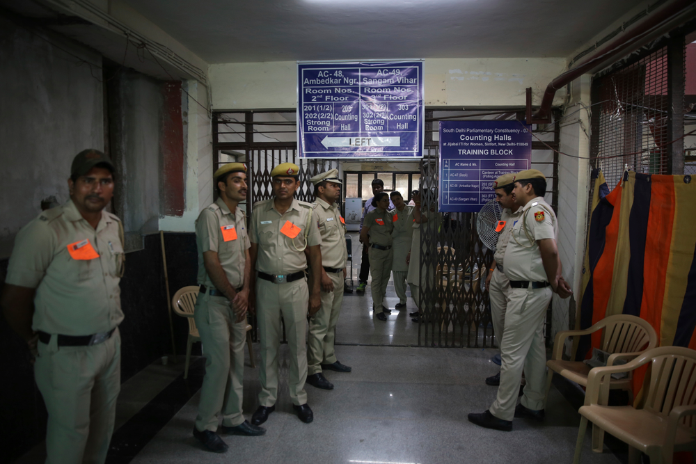 Indian policemen stand guard as counting votes of India's massive general elections begins in New Delhi, India, Thursday, May 23, 2019. The count is expected to conclude by the evening, with strong trends visible by midday. (AP Photo/Manish Swarup)