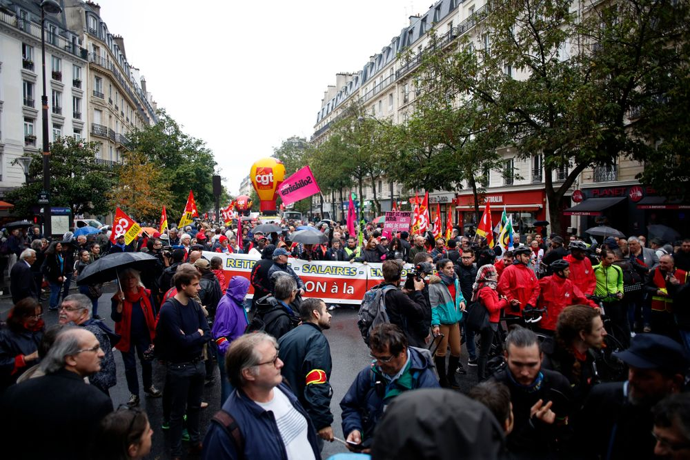 People attend a march over the pension reform, in Paris, Tuesday, Sept. 24, 2019. Unions marches in Paris and other cities over the pension reform, which they fear will require people to work longer and reduce pensions. France's current retirement age is 62. (AP Photo/Thibault Camus)