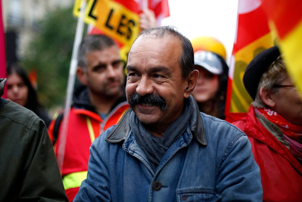 CGT labor union leader Philippe Martinez attends a march over the pension reform, in Paris, Tuesday, Sept. 24, 2019. Unions marches in Paris and other cities over the pension reform, which they fear will require people to work longer and reduce pensions. France's current retirement age is 62. (AP Photo/Thibault Camus)
