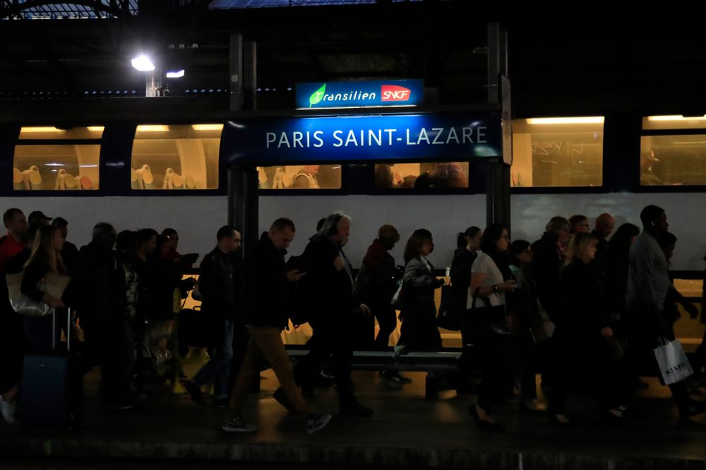Commuters arrive at Gare Saint Lazare train station in Paris, Tuesday, Sept. 24, 2019. A French rail strike is disrupting train travel and unions plan marches in Paris and other cities over President Emmanuel Macron's proposed overhaul of the retirement system. Workers for the SNCF national railway fear the reform will require people to work longer and reduce pensions. (AP Photo/Michel Euler)