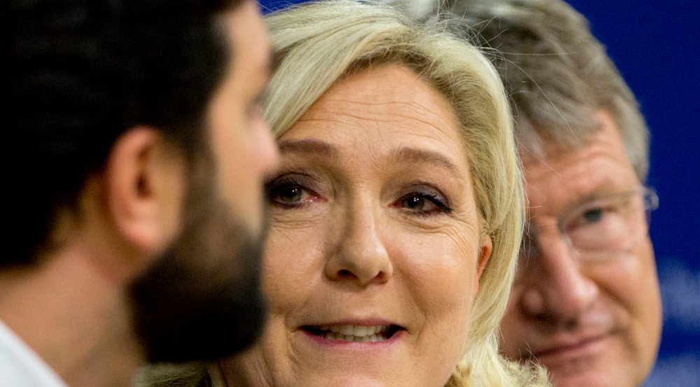 French far-right National Rally leader and MEP Marine Le Pen, center, attends a media conference to announce the formation of a new far-right European Parliament group at the European Parliament in Brussels, Thursday, June 13, 2019. (AP Photo/Virginia Mayo)