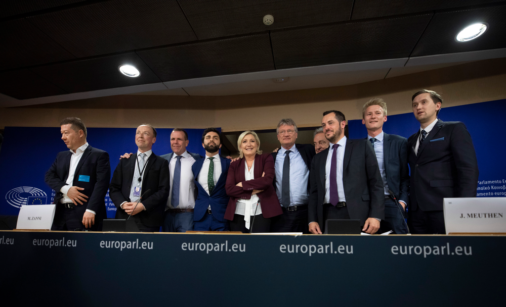 French far-right National Rally leader and MEP Marine Le Pen, center, poses with other far-right members during a media conference to announce the formation of a new far-right European Parliament group at the European Parliament in Brussels, Thursday, June 13, 2019. From left, Czech Republic's Tomio Okamura, Finland's Jussi Halla-Aho, Austria's Harald Vilimsky, Italy's Marco Zanni, Germany's Joerg Meuthen, Belgium's Gerolf Annemans, France's Nicolas Bay, Denmark's Peter Kofod and Estonia's Jaak Madison. (AP Photo/Virginia Mayo)