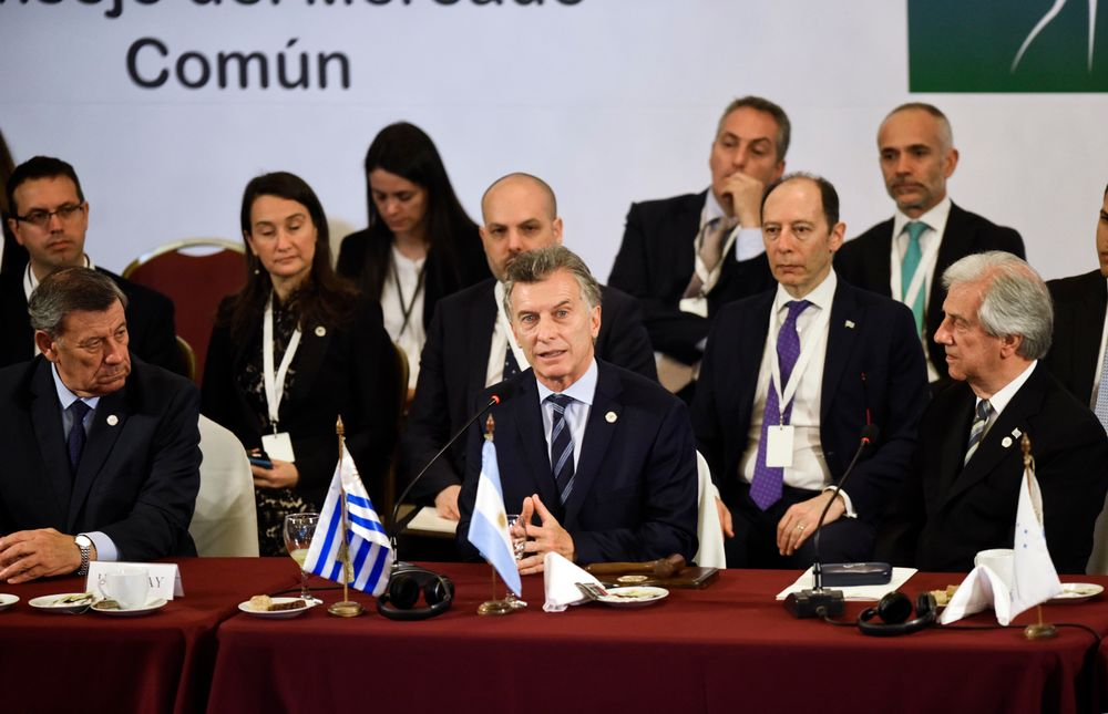 FILE - In this Dec. 18, 2018 file photo, Argentina's President Mauricio Macri speaks as the new pro tempore president of Mercosur, flanked by Uruguay's Foreign Affairs Minister, Rodolfo Nin, left and Uruguay's President Tabare Vazquez, right, at the 53rd Mercosur Summit in Montevideo, Uruguay. Argentina's Foreign Ministry said in a statement Friday, June 28, 2019, that South America's Mercosur trade bloc has struck a