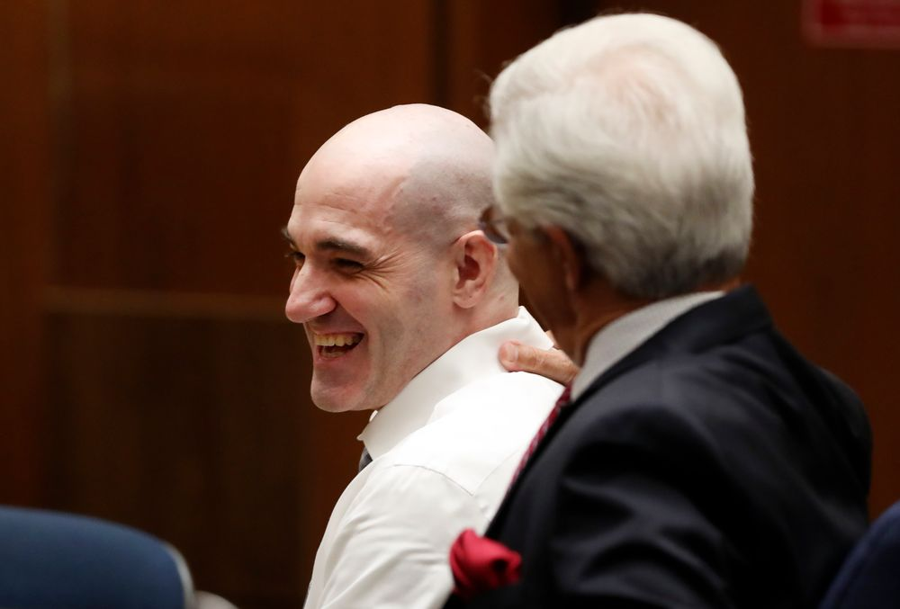 Michael Gargiulo, left, talks with his attorney Daniel Nardoni Tuesday, Aug. 6, 2019, in Los Angeles. Closing arguments started Tuesday in the trial of an air conditioning repairman charged with killing two Southern California women and attempting to kill a third. (Lucy Nicholson, Pool Photo via AP)