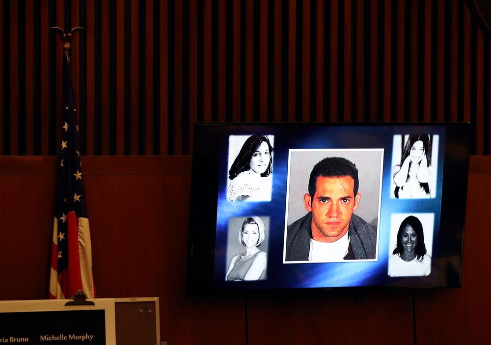 A picture of defendant Michael Gargiulo, center, and his victims is flashed on a screen during closing arguments for the trial of People vs. Michael Gargiulo Tuesday, Aug. 6, 2019, in Los Angeles. Closing arguments started Tuesday in the trial of an air conditioning repairman charged with killing two Southern California women and attempting to kill a third. (Lucy Nicholson, Pool Photo via AP)