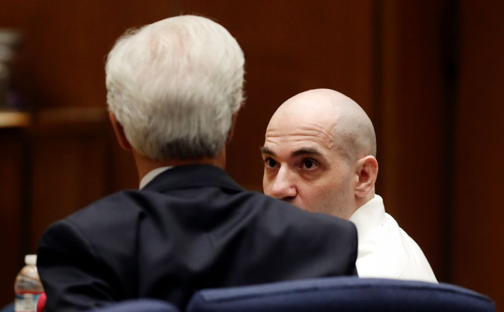 Michael Gargiulo, right, talks to his attorney Daniel Nardoni during a court appearance Tuesday, Aug. 6, 2019, in Los Angeles. Closing arguments started Tuesday in the trial of an air conditioning repairman charged with killing two Southern California women and attempting to kill a third. (Lucy Nicholson, Pool Photo via AP)