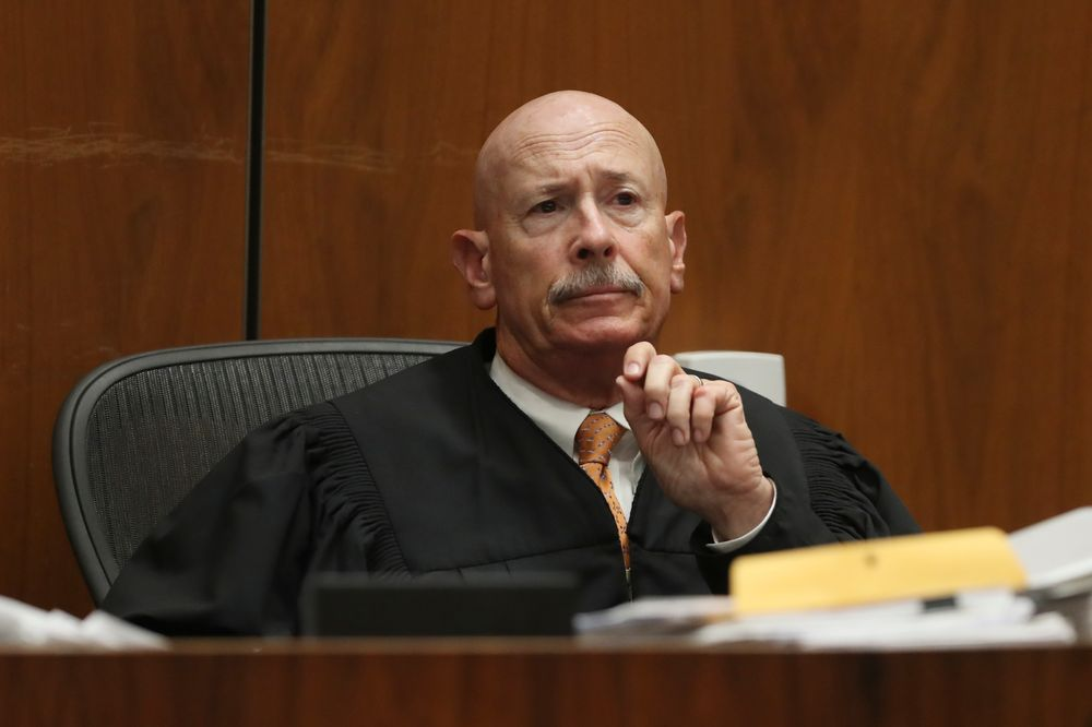 Judge Larry P. Fidler listens to closing arguments in the trial of People vs. Michael Gargiulo Tuesday, Aug. 6, 2019, in Los Angeles. Closing arguments started Tuesday in the trial of an air conditioning repairman charged with killing two Southern California women and attempting to kill a third. (Lucy Nicholson, Pool Photo via AP)