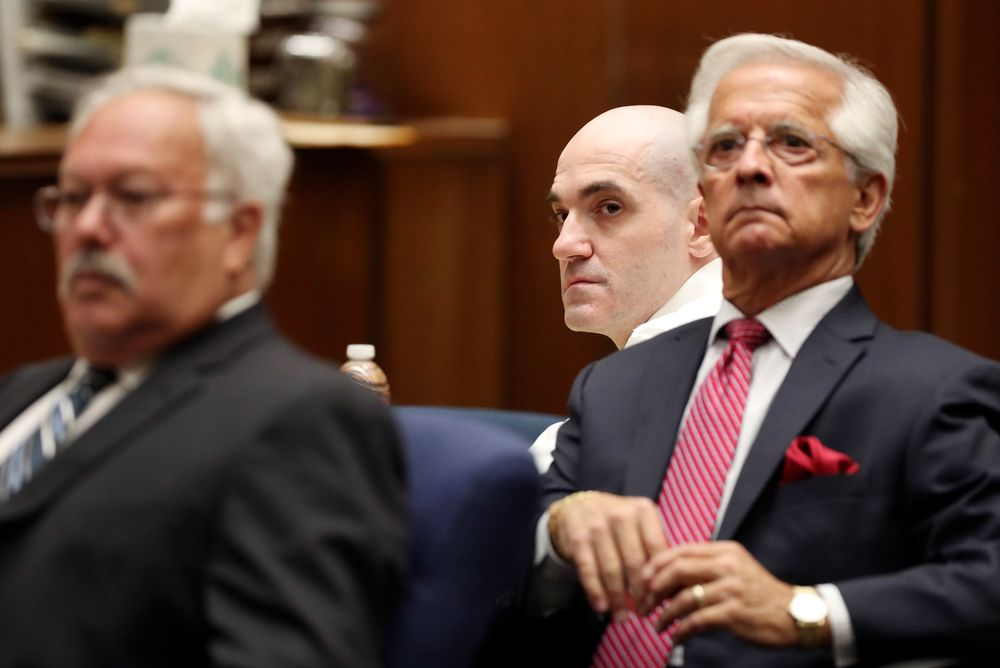 Michael Gargiulo, center, sits in front of his attorneys, Daniel Nardoni, right, and Dale Rubin during a court appearance Tuesday, Aug. 6, 2019, in Los Angeles. Closing arguments started Tuesday in the trial of an air conditioning repairman charged with killing two Southern California women and attempting to kill a third. (Lucy Nicholson, Pool Photo via AP)