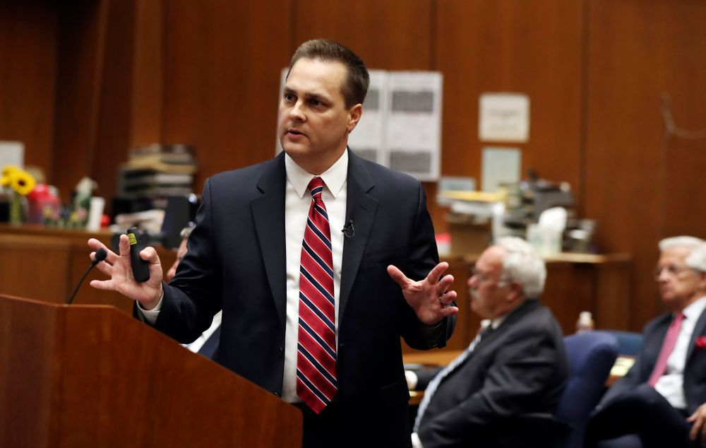Deputy District Attorney Garrett Dameron presents closing arguments in the People vs. Michael Gargiulo trial Tuesday, Aug. 6, 2019, in Los Angeles. Closing arguments started Tuesday in the trial of an air conditioning repairman charged with killing two Southern California women and attempting to kill a third. (Lucy Nicholson, Pool Photo via AP)