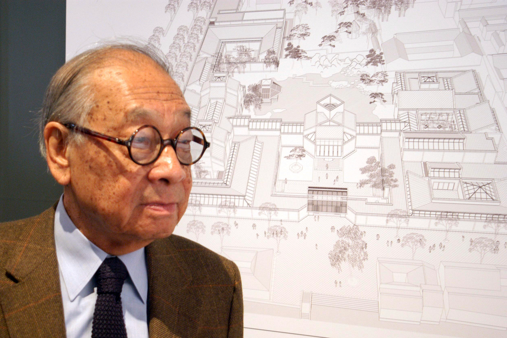 In this Nov. 3, 2003, photo, Chinese-American architect I.M. Pei stands with the plans of the Suzhou Museum in Suzhou in eastern China's Jiangsu Province. Pei, the versatile, globe-trotting architect who revived the Louvre with a giant glass pyramid and captured the spirit of rebellion at the multi-shaped Rock and Roll Hall of Fame, has died at age 102, a spokesman confirmed Thursday, May 16, 2019. (Chinatopix via AP)