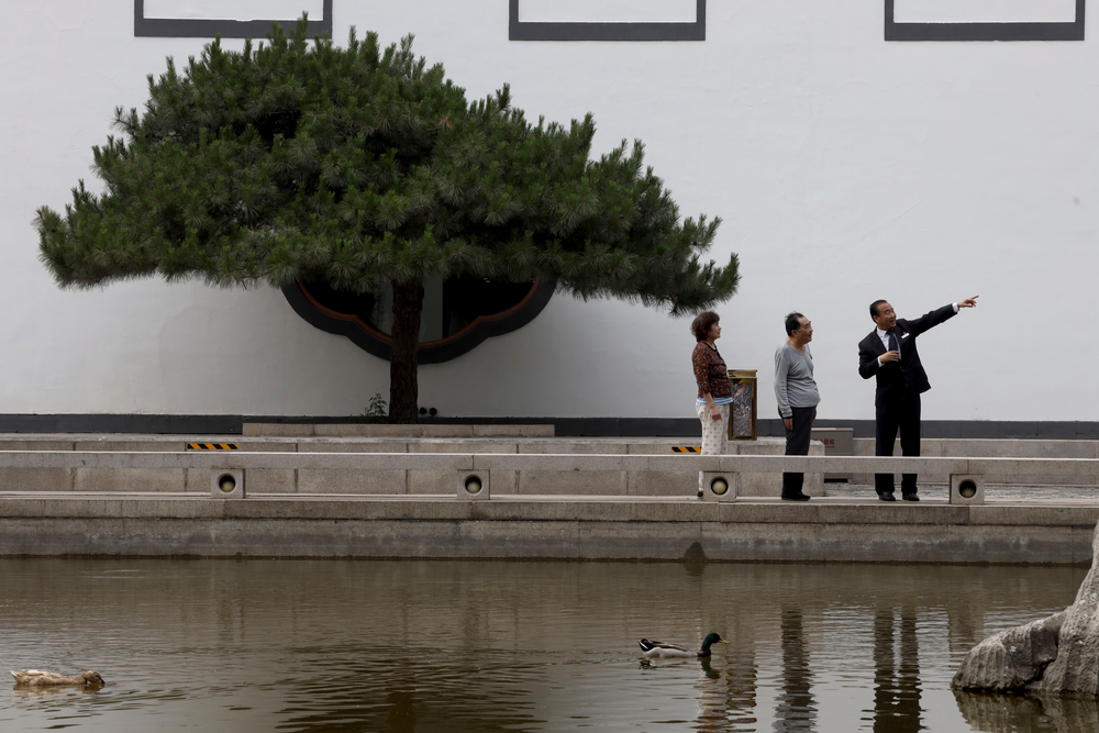 Hotel staff gives directions to visitors as ducks swim in a pond at the Xiangshan hotel designed by Chinese-American architect I.M. Pei and built in 1982 in Beijing, China on Friday, May 17, 2019. Pei, the globe-trotting architect who revived the Louvre museum in Paris with a giant glass pyramid and captured the spirit of rebellion at the multi-shaped Rock and Roll Hall of Fame, has died at age 102, a spokesman confirmed Thursday. (AP Photos/Ng Han Guan)