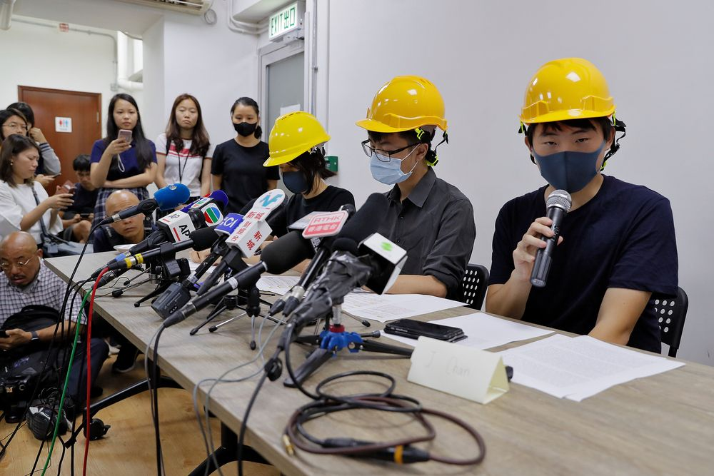 Protesters from right, Jerry Chan, Linus Kim and Mary Tsang attend a press conference in Hong Kong, Tuesday, Aug. 6, 2019. They condemned what they call the government's