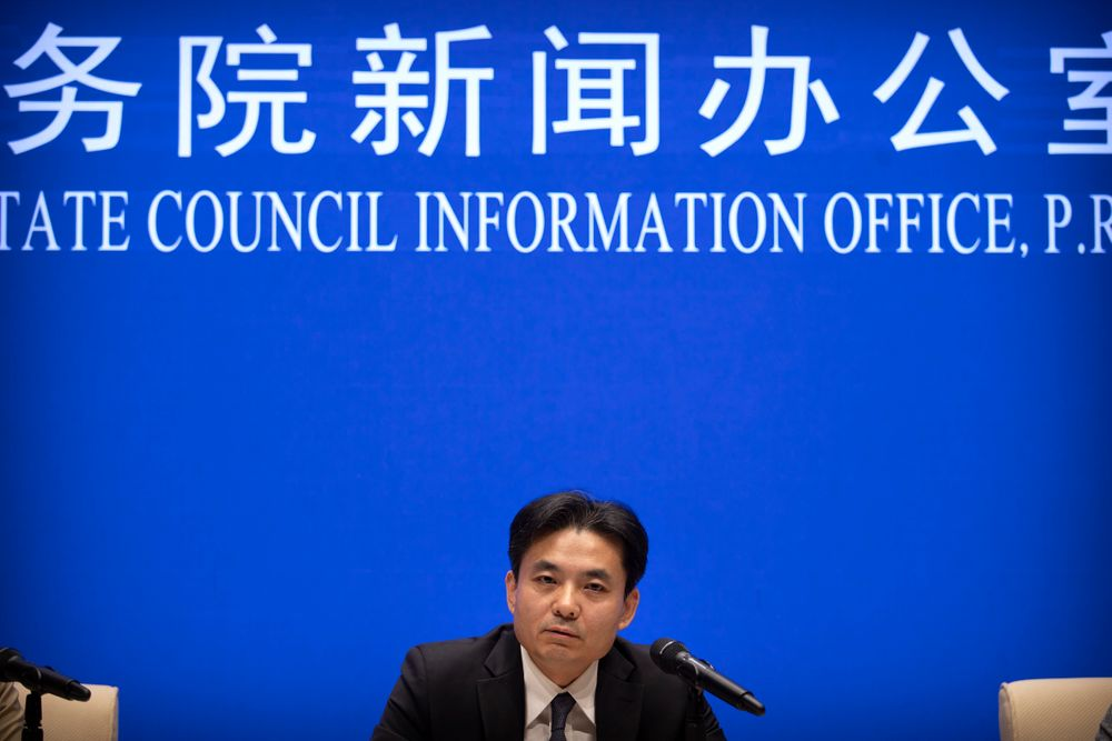 Yang Guang, spokesman for the Chinese Cabinet's Hong Kong and Macao Affairs Office, speaks during a press conference in Beijing, Tuesday, Aug. 6, 2019. A Chinese official responsible for Hong Kong affairs says punishment for those behind weeks of sometimes violent protests in the Chinese special administrative region is