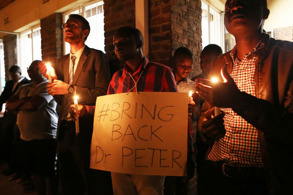 A night vigil prayer is held for a missing doctor, Peter Magombeyi, by well wishers and fellow doctors at Harare hospital in Zimbabwe Tuesday, Sept,17, 2019. The Zimbabwe Hospitals Association has said that that their president, Peter Magombeyi, was abducted on Saturday, days after receiving threats on his phone. Magombeyi had expressed concerns to journalists about the poor state of Zimbabwe,s hospitals.(AP Photo/Tsvangirayi Mukwazhi)