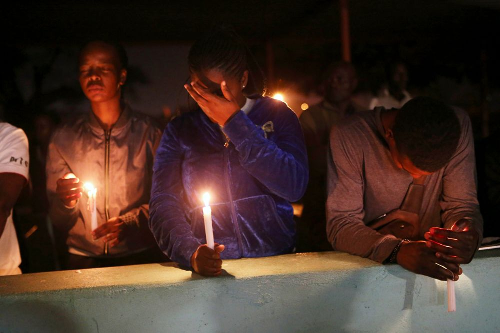 A night vigil prayer is held for a missing doctor, Peter Magombeyi, by well-wishers and fellow doctors at Harare hospital, Tuesday, Sept. 17, 2019. The Zimbabwe Hospitals Association has said that that their president, Peter Magombeyi, was abducted on Saturday, days after receiving threats on his phone. Magombeyi had expressed concerns to journalists about the poor state of Zimbabwe's hospitals.(AP Photo/Tsvangirayi Mukwazhi)