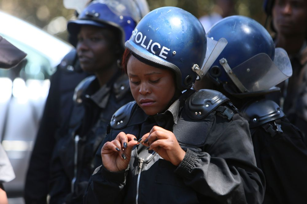 Armed riot police block doctors as they protest in Harare, Wednesday, Sept, 18, 2019. Zimbabwean doctors protesting the alleged abduction of a union leader were met by a line of baton- wielding police in the capital as fears grow about government repression. (AP Photo/Tsvangirayi Mukwazhi)