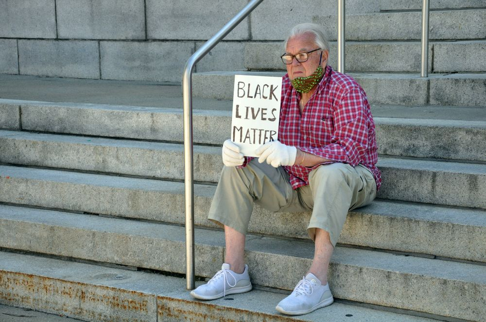 A protester on the stairs of the Westerly post office on High Street.
