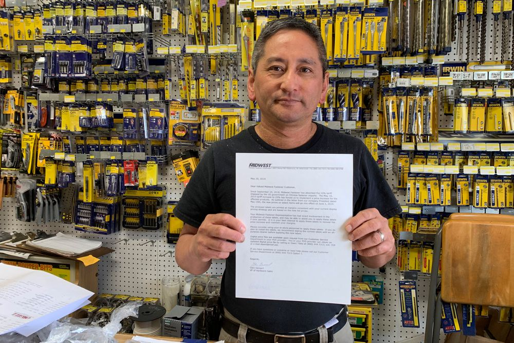 In this photo taken Wednesday, Aug. 28, 2019, Albert Chow, owner of Great Wall Hardware in San Francisco, holds a May 2019 letter from a supplier notifying him that prices will be increasing 10 to 18 percent because of US tariffs on Chinese goods. He says he has no choice but to raise store prices on those products. (AP Photo/Terry Chea)