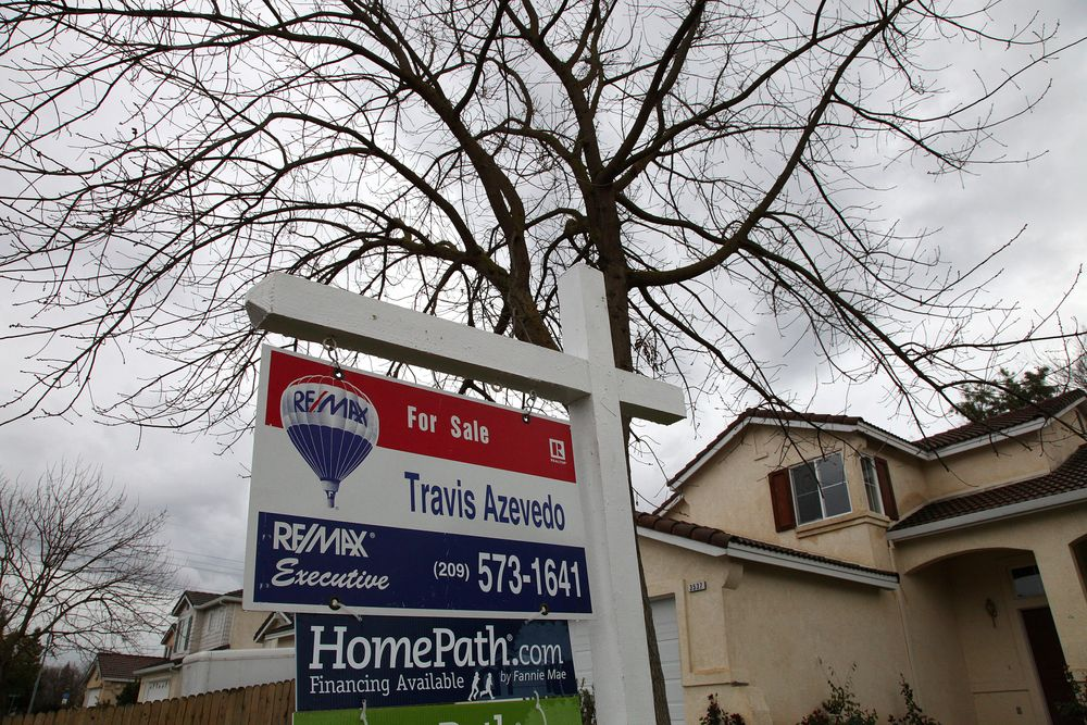 FILE -- In this Feb. 29. 2012 file photo a for sale sign is seen on the lawn of a foreclosed home in Stockton, Calif. Stockton has twice topped Forbes magazine's list of