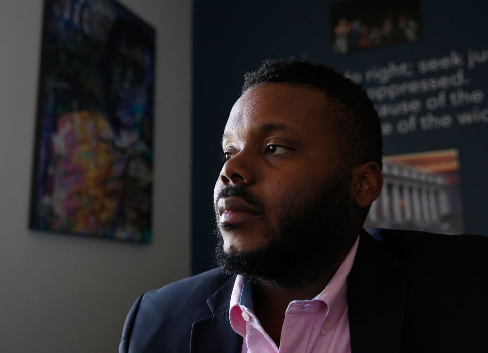 In this photo taken Wednesday Aug. 14, 2019 Stockton Mayor Michael Tubbs initiated a program to give $500 to 125 people who earn at or below the city's median household income of $46,033 during an interview in Stockton, Calif. They get the money on a debit card on the 15th of each month to spend any what they want. Tubbs says the program, which is privately funded, could be a solution to the city's poverty problem. (AP Photo/Rich Pedroncelli)
