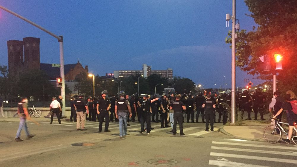 Police moved protesters who were blocking the intersection in front of the Providence police complex.