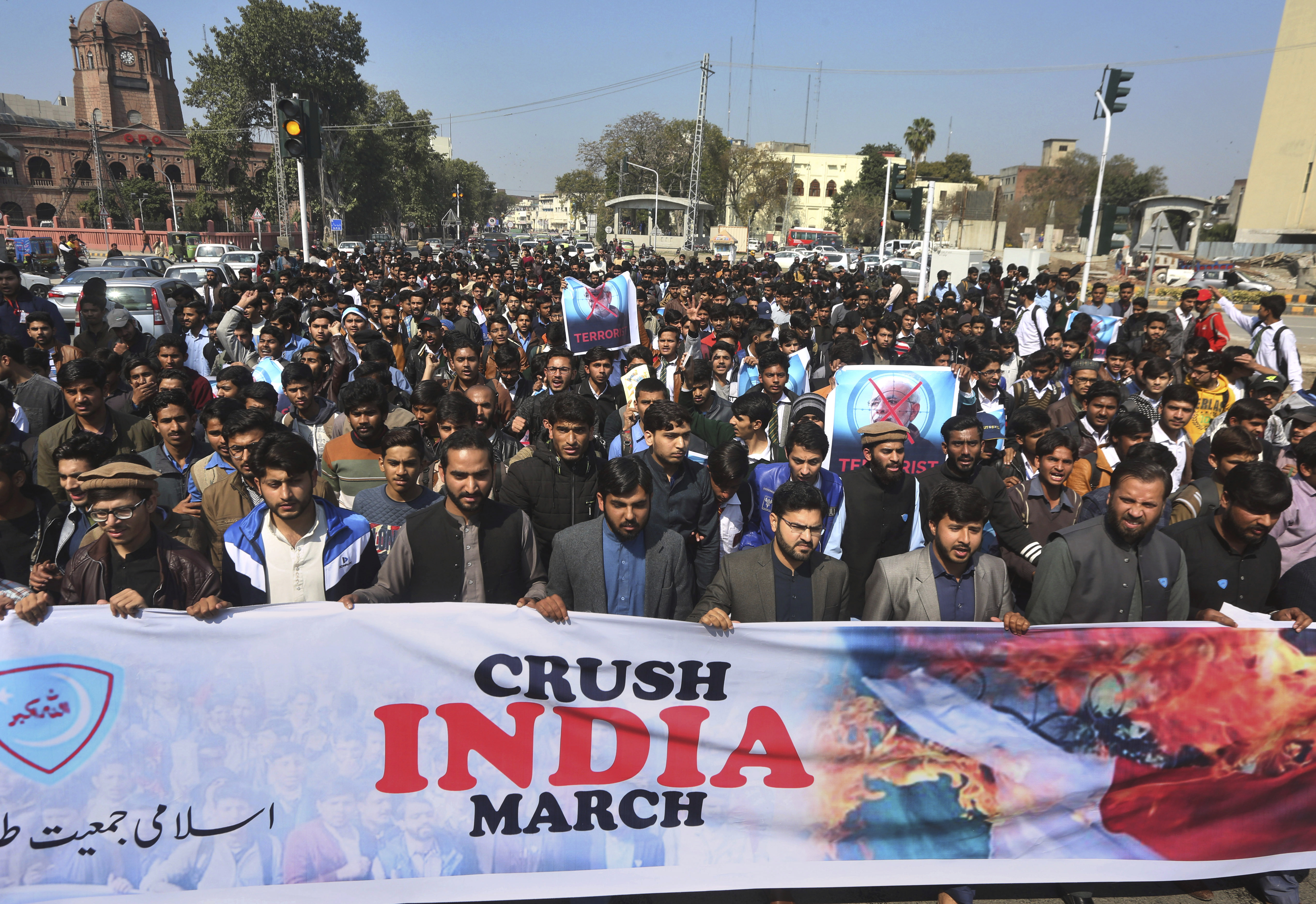 Supporters of a Pakistani religious group Islami Jamiat-e-Talaba hold a rally against India, Wednesday, Feb. 27, 2019. Pakistan's air force shot down two Indian warplanes after they crossed the boundary between the two nuclear-armed rivals in the disputed territory of Kashmir on Wednesday and captured one Indian pilot, a military spokesman said. (AP Photo/K.M. Chaudary)
