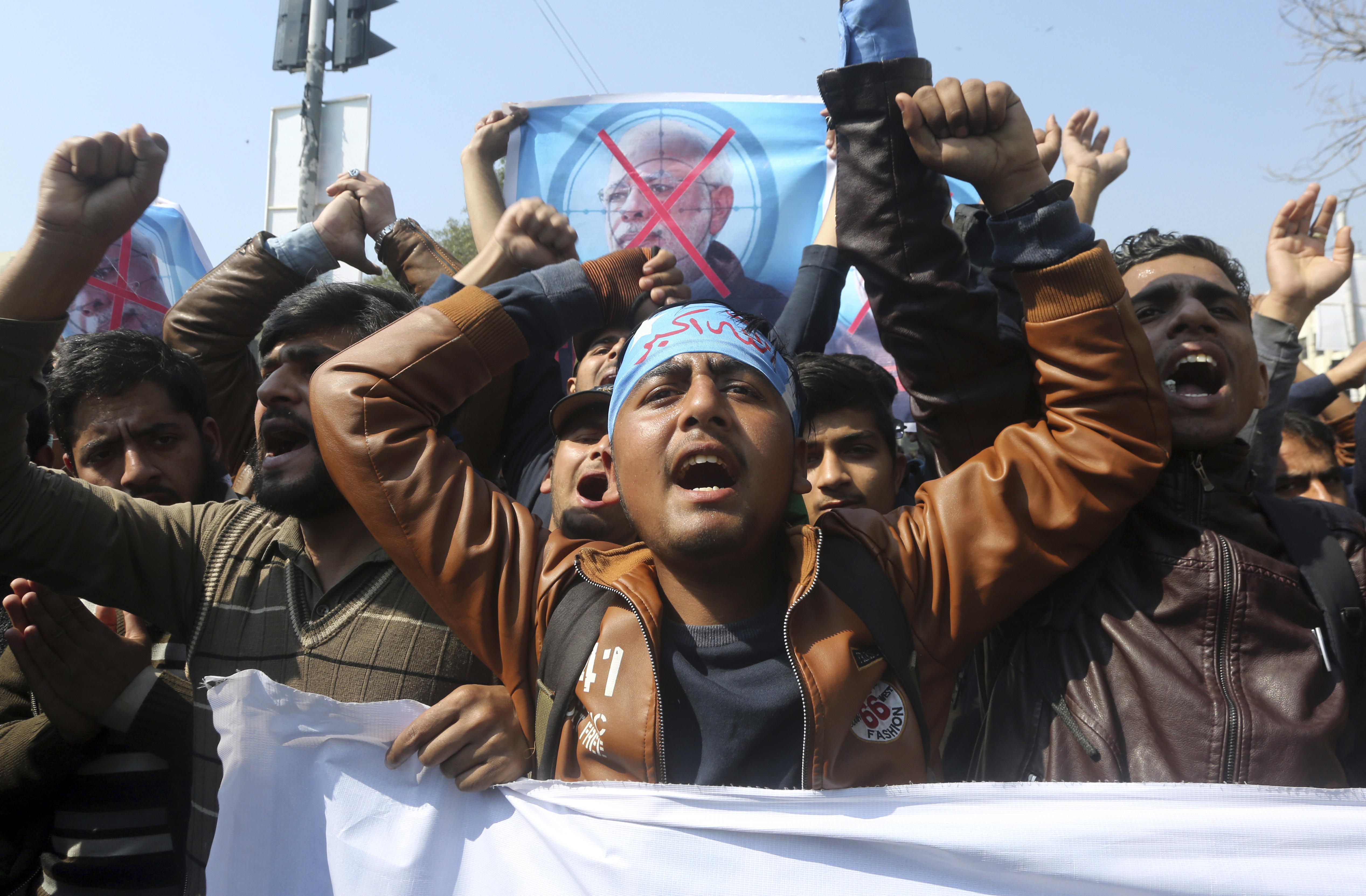 Supporters of a Pakistani religious group Islami Jamiat-e-Talaba chant slogans at a rally against India, Wednesday, Feb. 27, 2019. Pakistan's air force shot down two Indian warplanes after they crossed the boundary between the two nuclear-armed rivals in the disputed territory of Kashmir on Wednesday and captured one Indian pilot, a military spokesman said. (AP Photo/K.M. Chaudary)