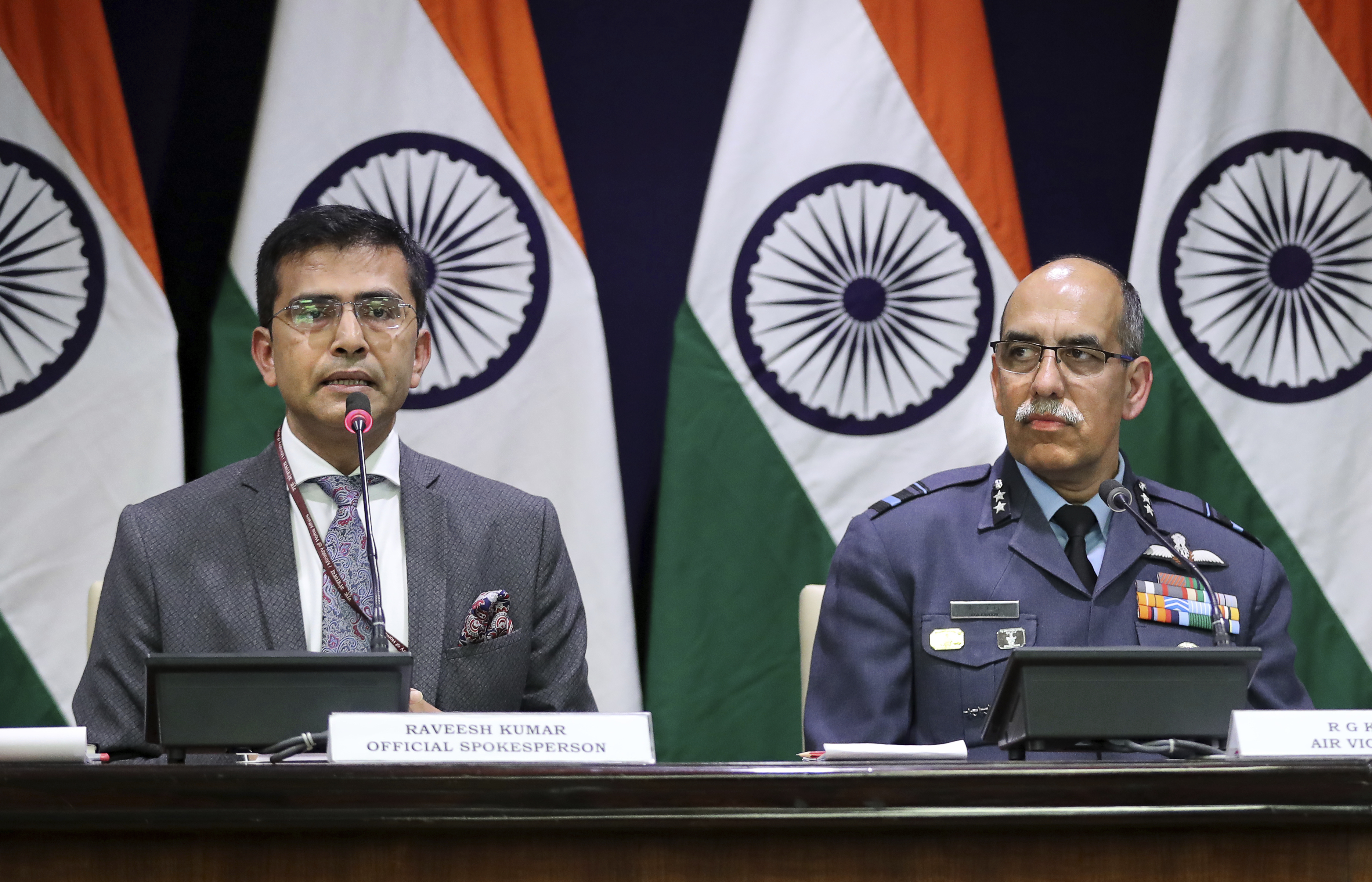 Indian Foreign Ministry spokesperson Raveesh Kumar, left, with Indian Air Force Air Vice Marshal R.G.K. Kapoor gives a statement in New Delhi, India, Wednesday, Feb. 27, 2019. Pakistan's air force shot down two Indian warplanes after they crossed the boundary between the two nuclear-armed rivals in the disputed territory of Kashmir on Wednesday and captured two Indian pilots, one of whom was injured, a Pakistani military spokesman said. Kumar said one of its Mig-21 fighter aircraft was missing and that India was still