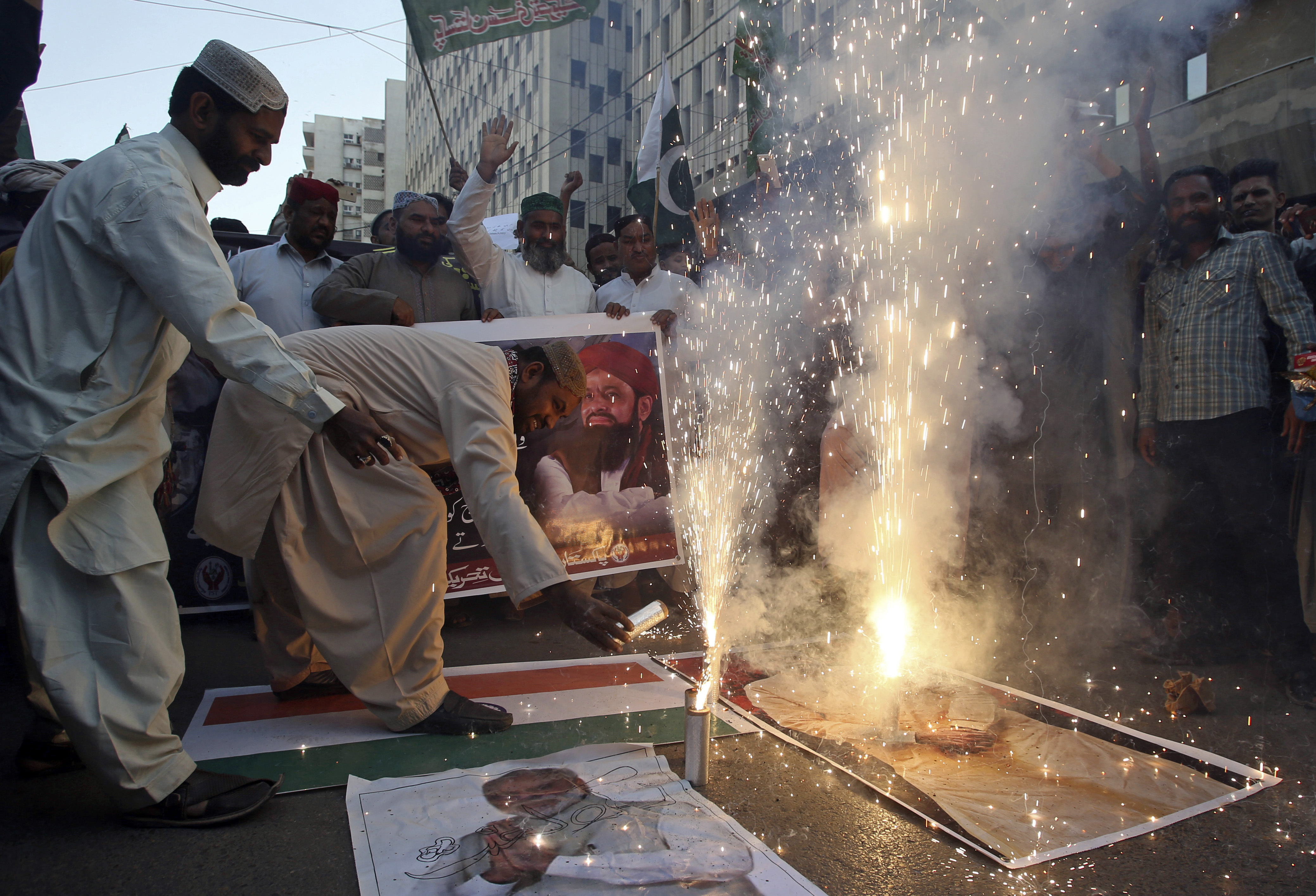 People celebrate the shooting down of Indian planes by Pakistani forces with fireworks, in Karachi, Pakistan, Wednesday, Feb. 27, 2019. Pakistan's military said Wednesday it shot down two Indian warplanes in the disputed region of Kashmir and captured two pilots, raising tensions between the nuclear-armed rivals to a level unseen in 20 years. (AP Photo/Fareed Khan)