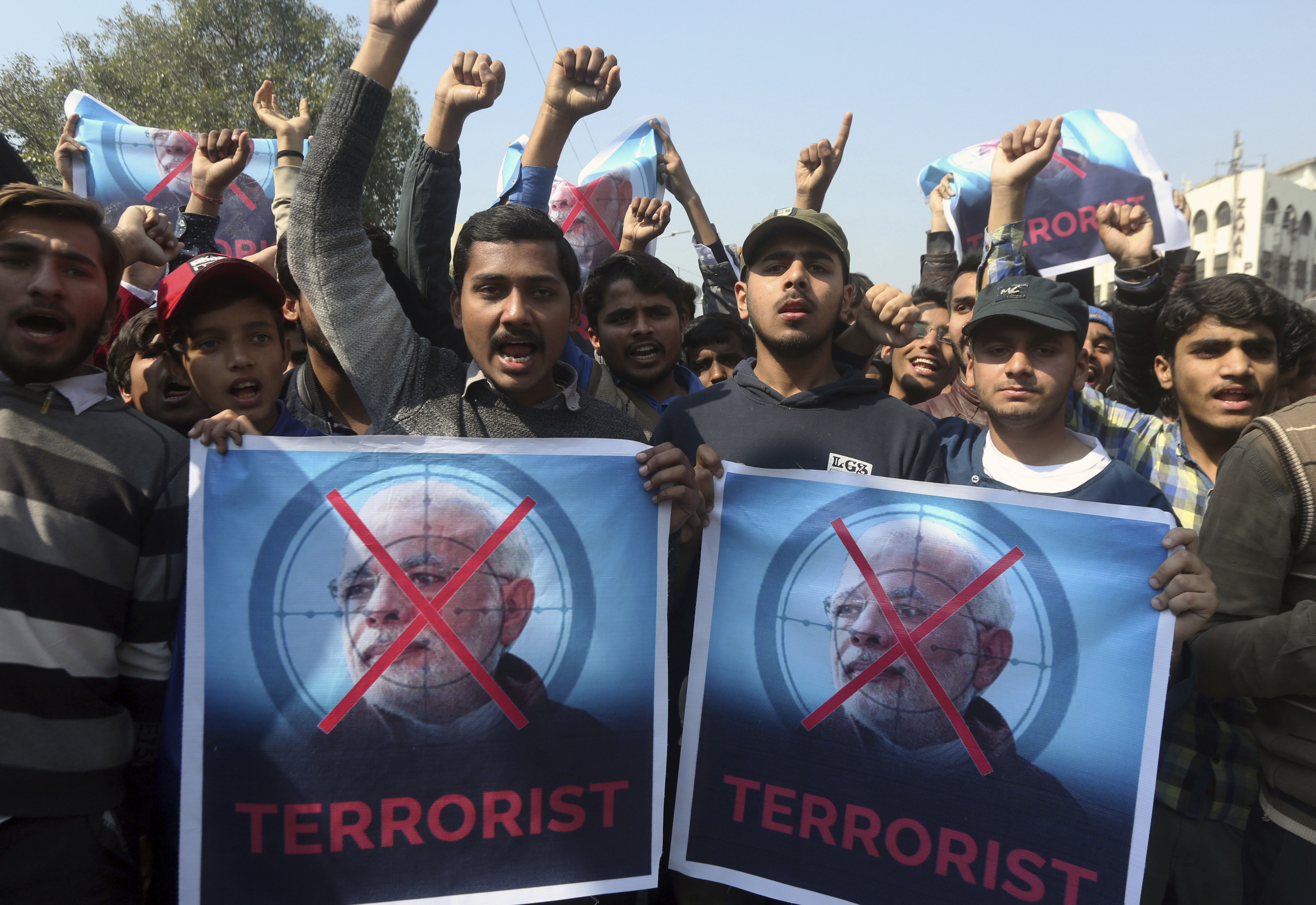 Supporters of a Pakistani religious group Islami Jamiat-e-Talaba chant slogans at a rally to condemn Indian aggression, Wednesday, Feb. 27, 2019. Pakistan's air force shot down two Indian warplanes after they crossed the boundary between the two nuclear-armed rivals in the disputed territory of Kashmir on Wednesday and captured one Indian pilot, a military spokesman said. (AP Photo/K.M. Chaudary)