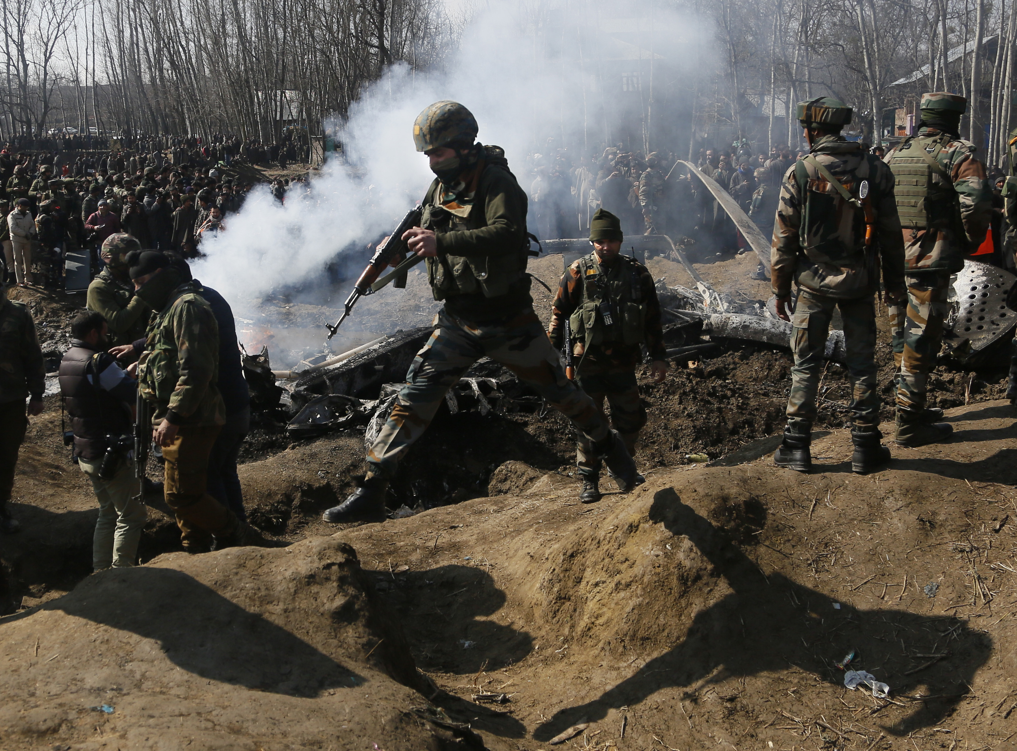 Indian army soldiers arrive near the wreckage of an Indian aircraft after it crashed in Budgam area, outskirts of Srinagar, Indian controlled Kashmir, Wednesday, Feb.27, 2019. (AP Photo/Mukhtar Khan)
