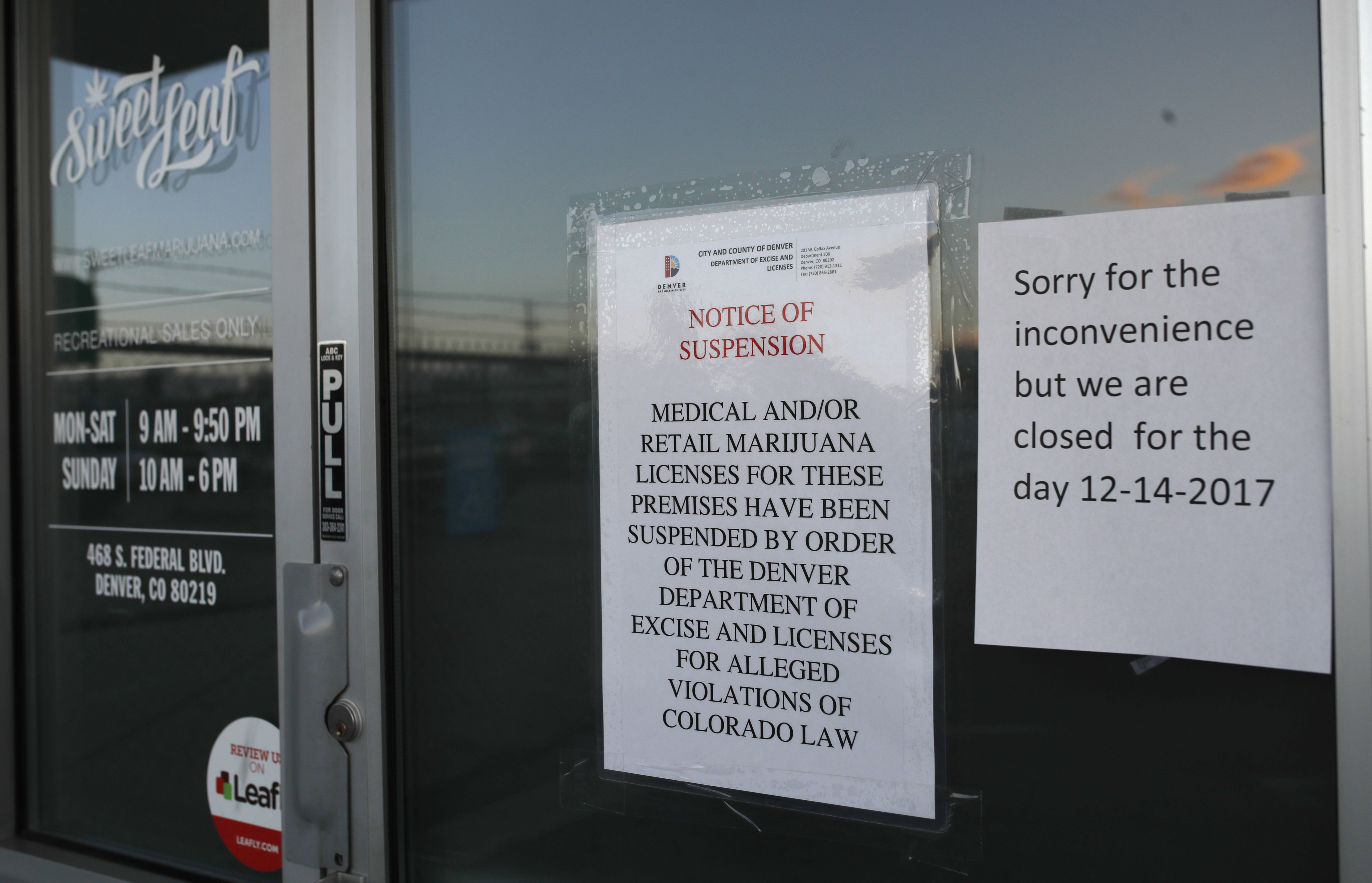 FILE - In this Dec. 14, 2017 file photo closed signs are displayed on the front door to a marijuana dispensary along South Federal Boulevard in south Denver. The owners of the Denver marijuana business pleaded guilty Friday, Jan. 25, 2019 to drug and racketeering charges stemming from a yearlong grand jury investigation that prosecutors say uncovered more than two tons of marijuana entering the black market.(AP Photo/David Zalubowski,File)