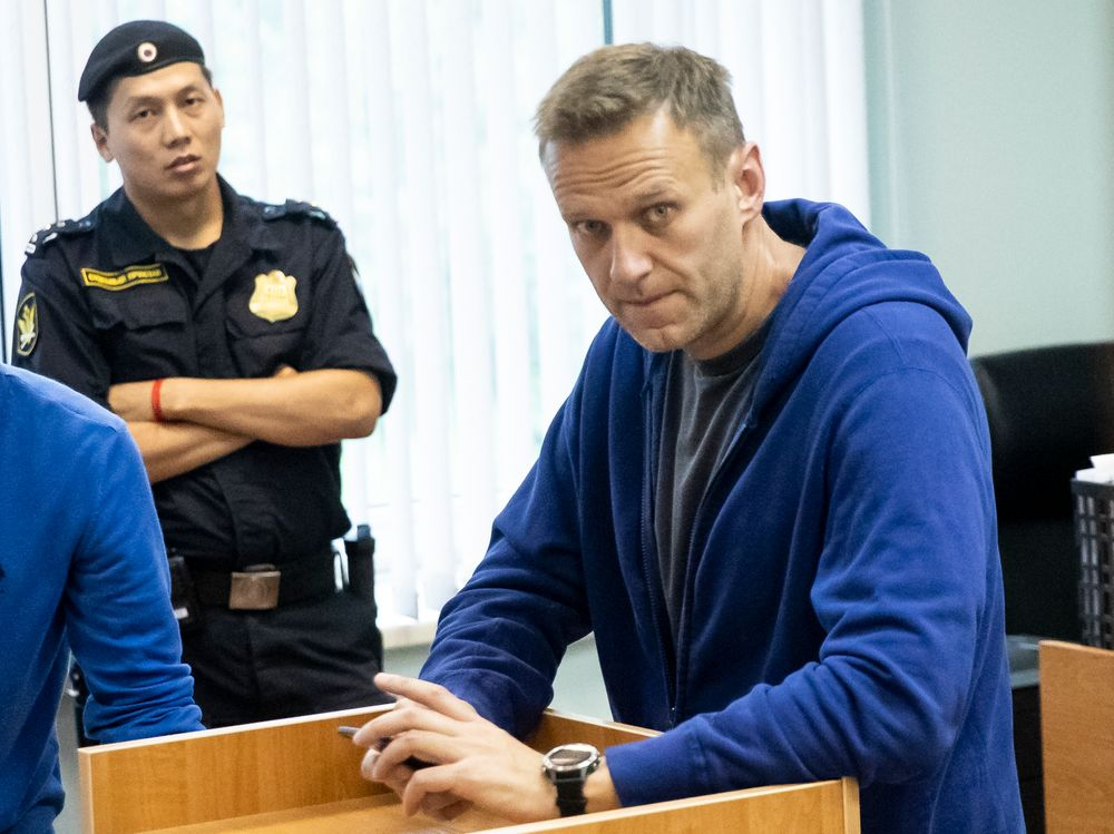 Alexei Navalny, Russia's most prominent opposition figure, who has been detained by police and charged with unlawfully organizing a public gathering, sits in a court room in Moscow, Russia, Wednesday, July 24, 2019. Navalny has called for demonstrators to protest on Saturday outside the mayor's office against the rejection of several opposition candidates from the ballot for the Moscow city council elections. (AP Photo/Pavel Golovkin)